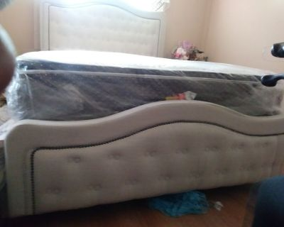 Brand new bed set with plastic still on mattresses... 5595478582
