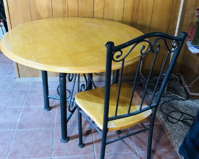 Wood round table with decorative metal and 4 chairs
