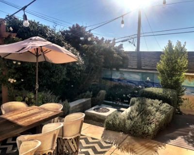 Lush, Gorgeous Backyard with Firepit, Couch Swing, Mural and Little Water Fountain, Los Angeles, CA