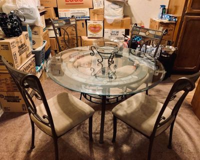 Glasstop dining room table and chairs