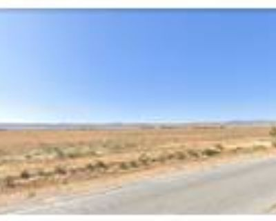 4.65 acres on Highway 138 at 111th Street West in the Antelope Acres area
