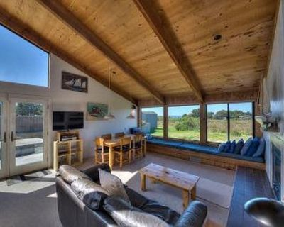 Wide open meadow view with ocean peeks through the trees. - Sea Ranch