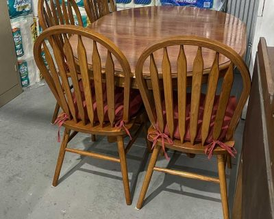 Refinished wood table with four chairs