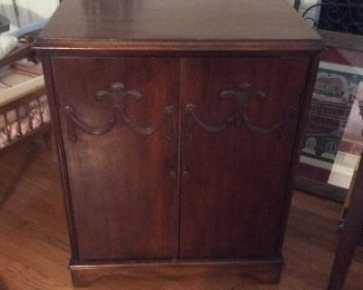 How old record player cabinet with ornate front