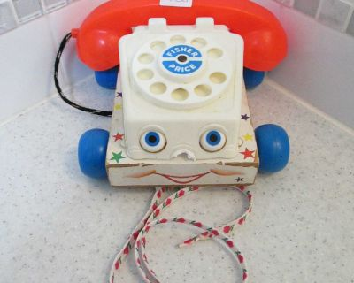 Well-loved vintage Fisher Price toy phone
