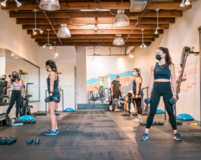 Bright Open Fitness Studio With Exposed Beams, White Walls, Huge Mirror in Oakland Neighborhood Shopping District, Oakland, CA