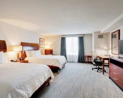 2 Connecting Suites with 3 beds and 1 sofabed at a Full Service Hotel by Suiteness - Milwaukee
