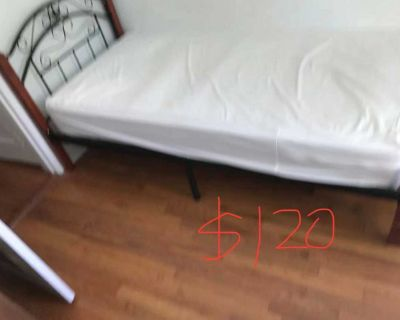 twin-sized mattress and bed frame
