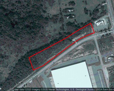 3.93 +/- Acres Zoned Commercial