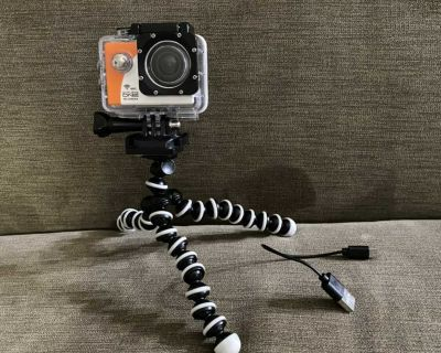 Action camera with tripod and water proof cards!