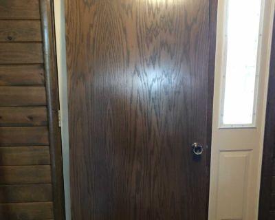 32 x80 indoor brown door. Includes hinges and handles
