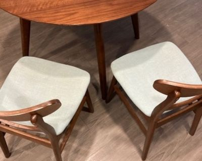 Dining table set (two chairs and a round table) from Wayfair