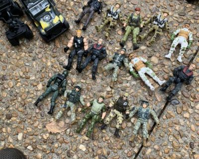 Army dudes and two vehicles