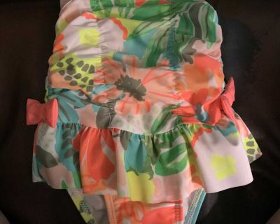 NWOT washed not worn, 12 months swimsuit with snaps at bottom. Brand Cat and Jacks