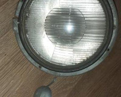 Original Hella Headlight Assembly 0301704002