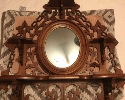 Beautiful antique wall mirror with shelves