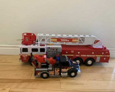 Large fire truck and tow truck