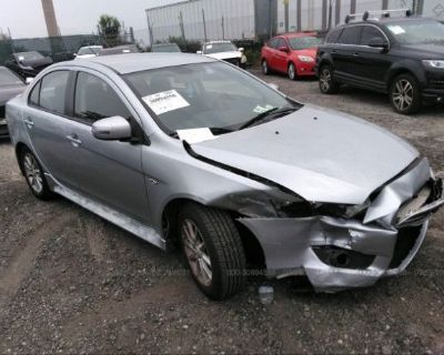 Salvage Silver 2015 Mitsubishi Lancer