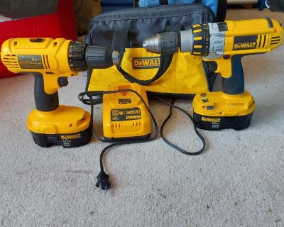 Dewalt drills with charger and two batteries with a case