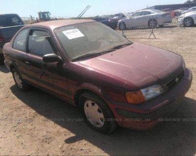 Salvage Maroon 1995 Toyota Tercel