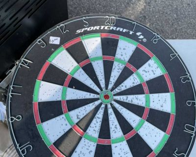 Sports craft dart board, has another game on the back