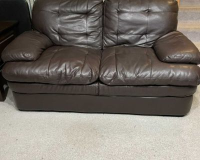 Couch and loveseat with footrest