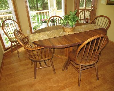 Solid red oak kitchen table with 6 chairs