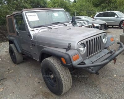 Salvage Green 2002 Jeep Wrangler