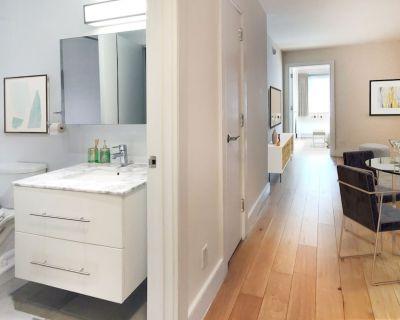 Renovated 1 Bedroom Apartment in Luxury Building w/ Rooftop Patio, Doorman & Gym - Turtle Bay