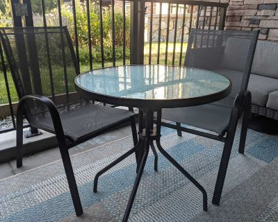 Round Patio Table and 2 Sling Chairs