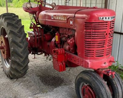 1952 International Farmall Super M pulling tractor