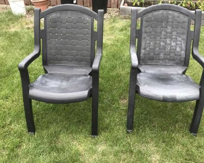 Two plastic sturdy deck or lawn chairs