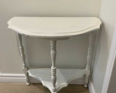Distressed white wooden side table