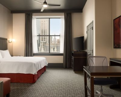 2 Connecting Suites with 2 beds and 2 sofabeds at a Full Service Hotel by Suiteness - East Town