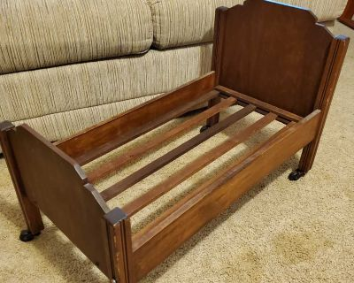 Vintage wood doll bed on casters