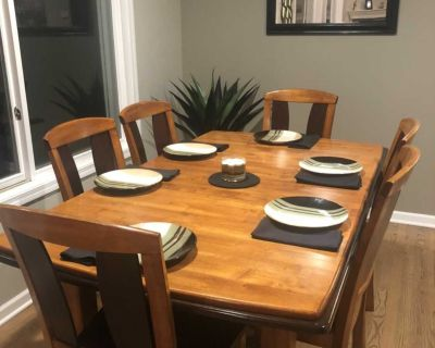 Dining room table with six chairs. Finish is worn in a few places.