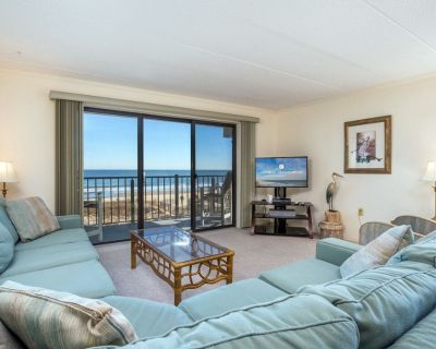 Enjoy panoramic views of the beach from the living room, dining room, kitchen and master bedroom. - Midtown Ocean City