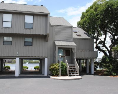 Villa overlooking lake near ocean located within gated Litchfield By the Sea community. - Litchfield by the Sea
