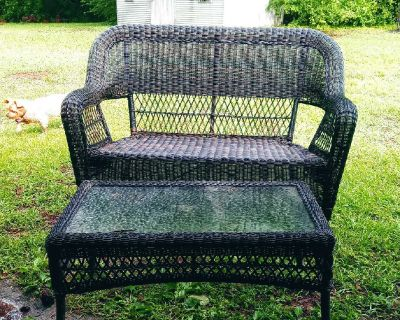 Wicker bench and glass top table