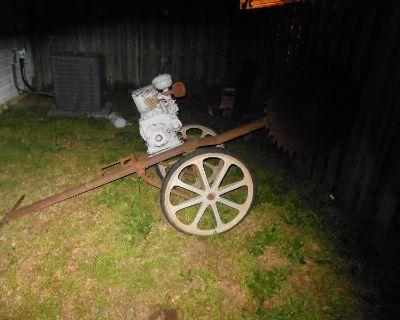 old firewood buck saw