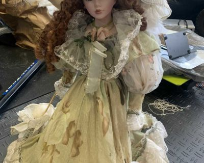 Beautiful large porcelain doll with hoop dress