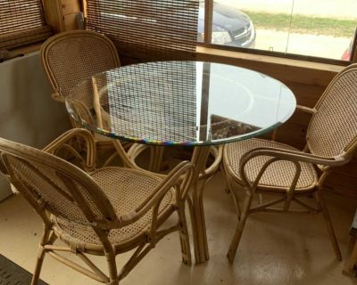 Vintage rattan table and three chairs