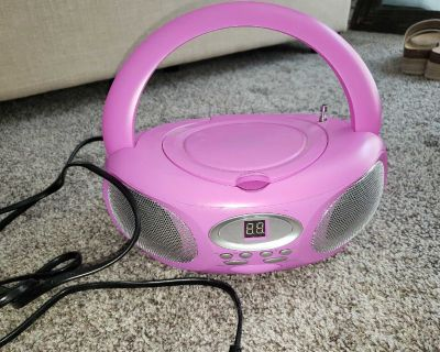 Portable CD player. Can also run off of batteries.
