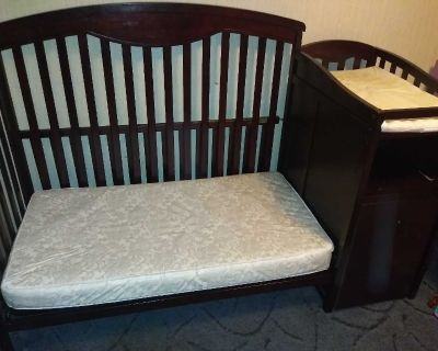 Baby convertible crib good condition. Has a few scuffs nothing major. Slide out drawer needs a wheel on it but we have the wheel.