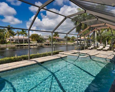 SW Cape Coral Vacation Rental 4 Bedroom 2 bathroom Home, Pool, and Dock - Gone Coastal - Pelican