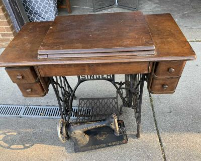 Old singer sewing machine and table