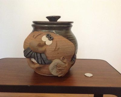 Funny face cookie jar