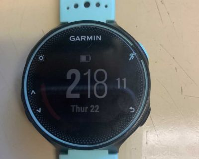 Garmin Forerunner 235 watch. Includes charger, screen protectors, and box with instructions.