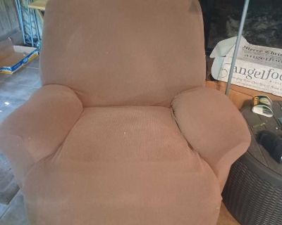 Recliner has brown chair cover.