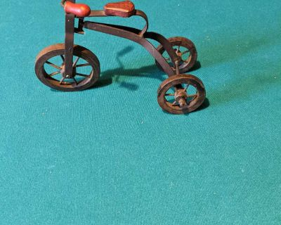 Little wood and metal tricycle
